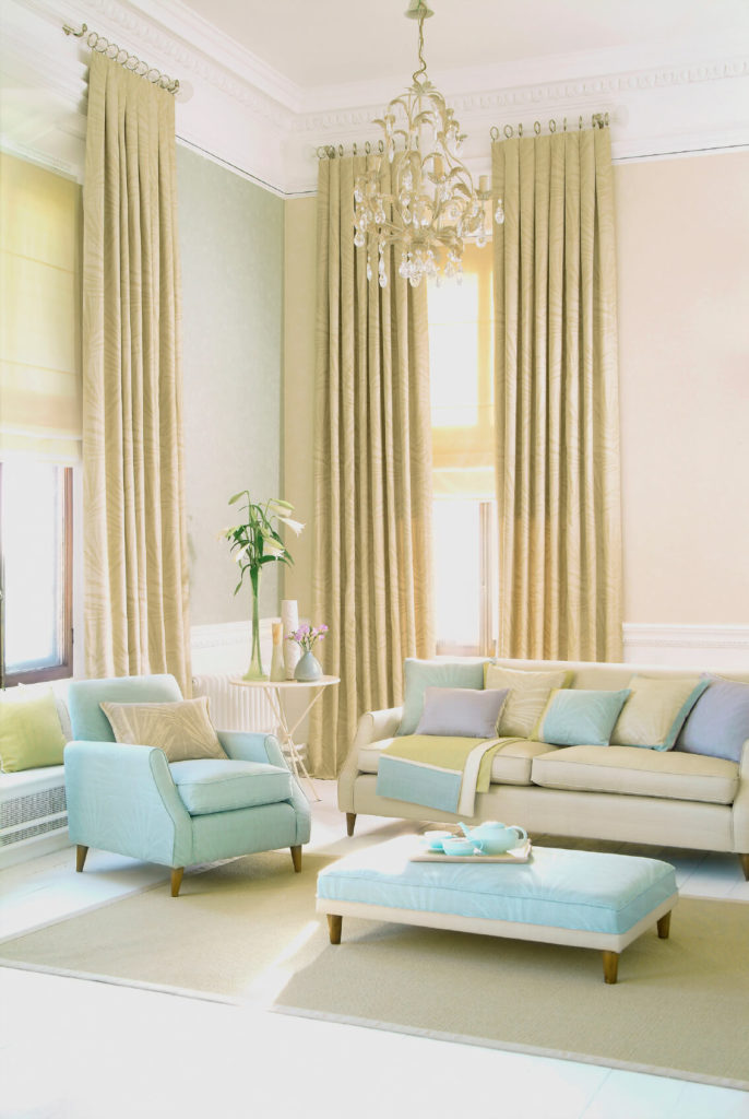 The height of these curtains lengthens the room and adds color to the neutral walls.