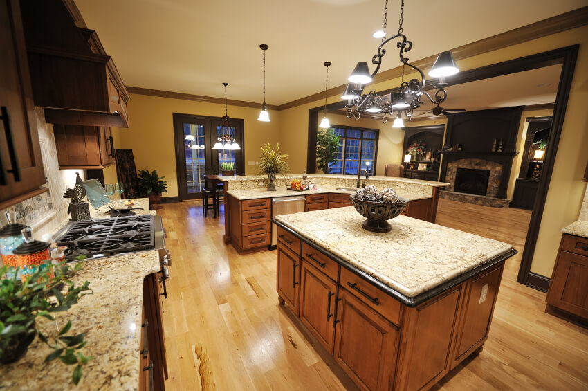 This Marvelous Kitchen Features Beautiful Granite Countertops Warm Wood Cabinets And A Pale