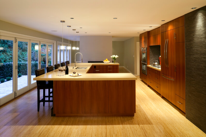 This Clean Cut Kitchen Is Brightened By The Light Wood Floor And Matching Countertops