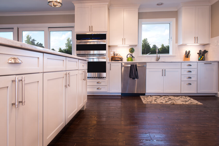 Fine Dark Wood Floor Kitchen White Cabinetry With Stainless Steel Hardware Glows In Throughout Innovation Ideas