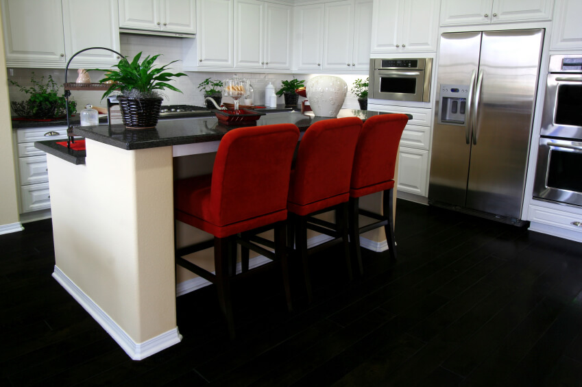 Captivating This Ultra Contrasting Kitchen Sets White Cabinetry Over A Deep Black Floor,  With Matching