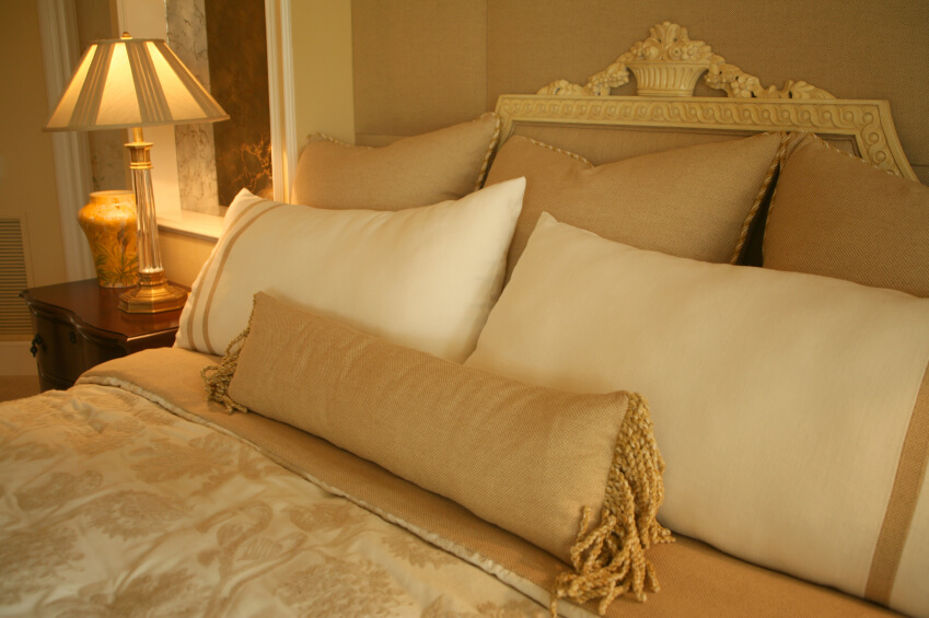 soft decorative pillows. The gold and ivory design scheme of this room the intricate attention  to detail make 50 Decorative King Queen Bed Pillow Arrangements Ideas