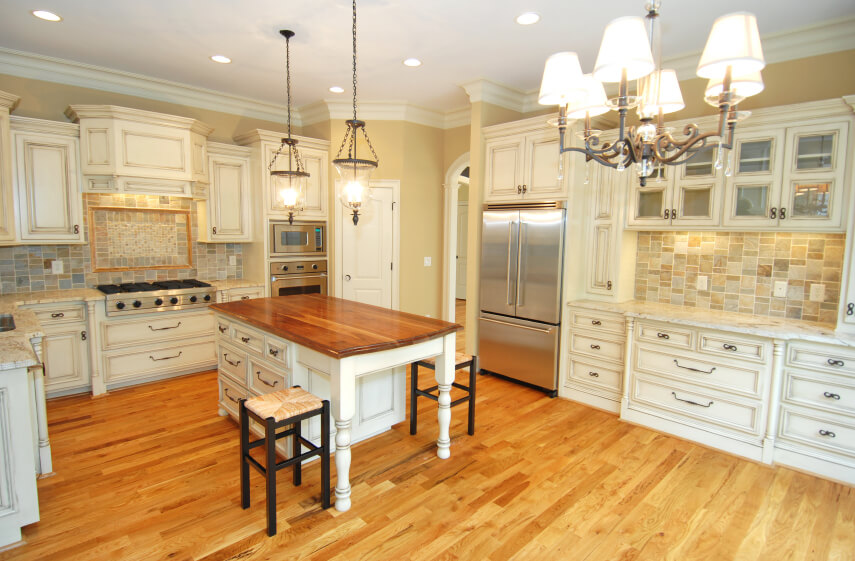 This White Kitchen Features Light Honey Hardwood Flooring And A Near Matching Island Countertop