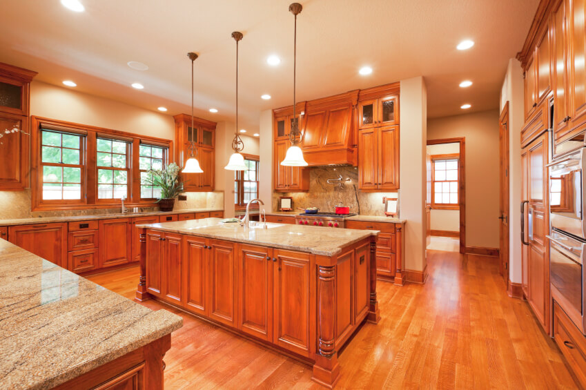 The Light Wood Floors Of This Kitchen Brighten Already Warm Space Created By Cabinetry