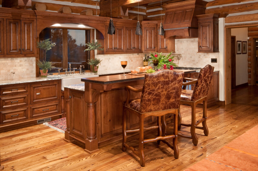 This Light Wood Floor Brightens Up The Dark Wood Of These Cabinets While  Accenting The Rustic