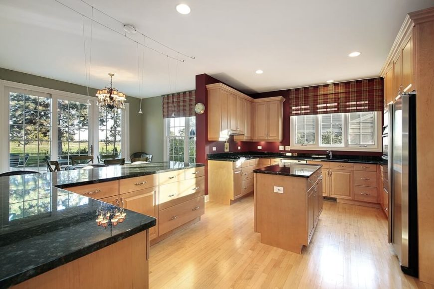 The light wood of these floors and cabinets balances the bold wall colors and dark countertops & 52 Enticing Kitchens with Light and Honey Wood Floors (PICTURES)
