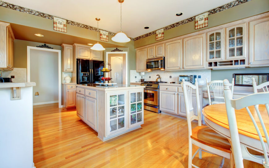 The Blanched Wood Of The Cabinets Adds A Flash Of Brightness Over The  Beautiful Honey