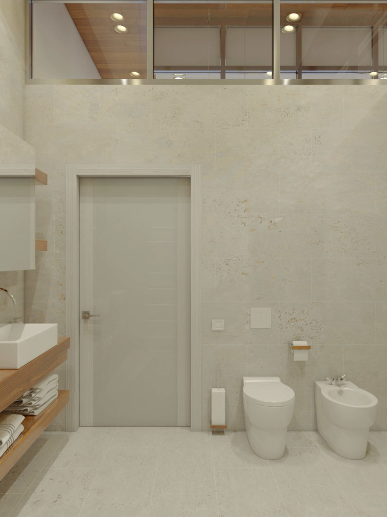 The focus on minimalism is especially apparent in the bathroom, with simple wall-mounted toiletries and shelving as the only accoutrements.