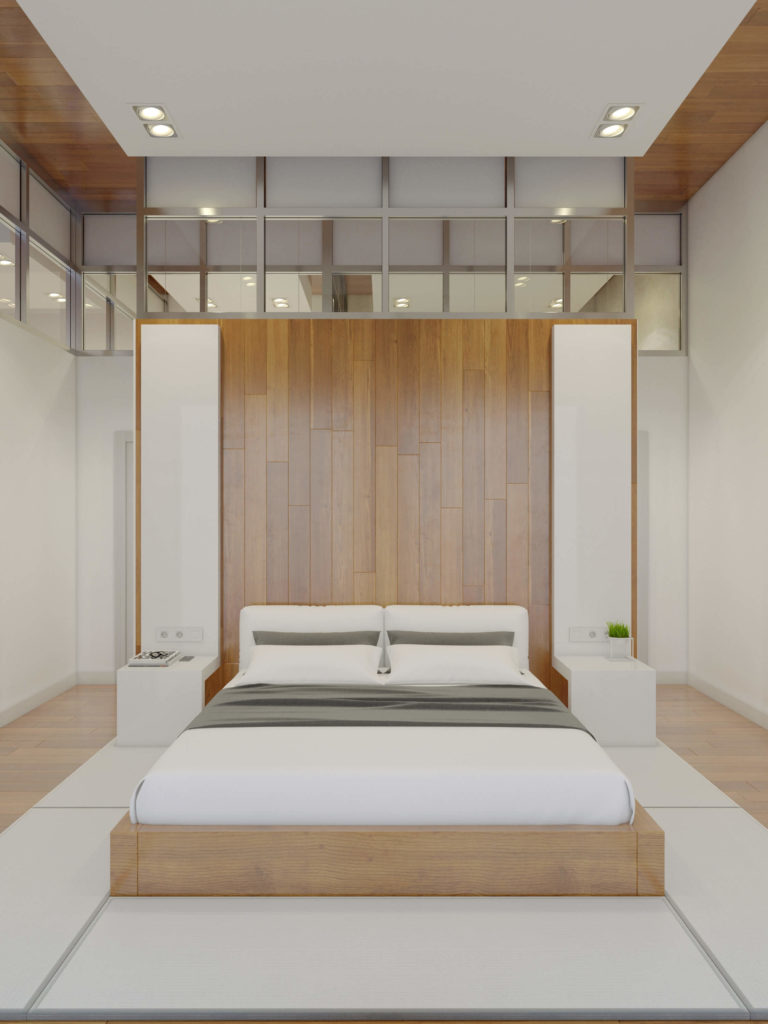 The master bedroom is an exercise in symmetry, with a large dividing wall doubling as headboard behind the bed. The natural wood frame is mounted on white floor panels.