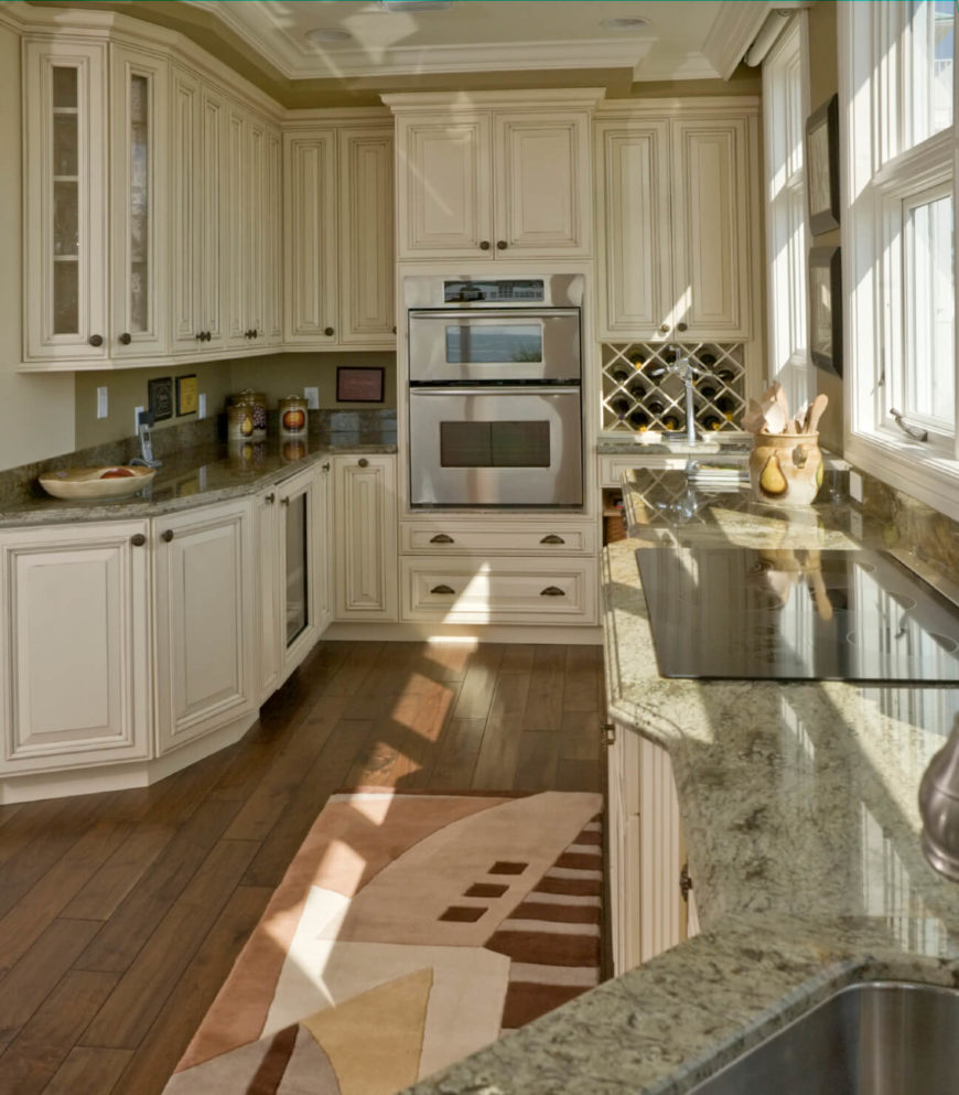 35 striking white kitchens with dark wood floors pictures this kitchen makes the most of its narrow presence with bold and detailed white cabinetry over