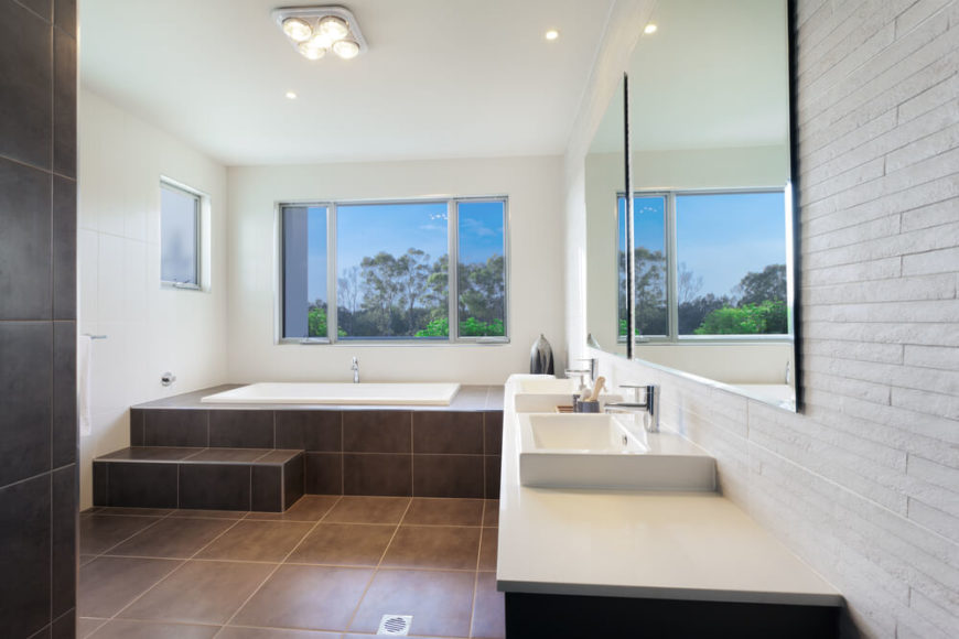 This Sleekly Modern Bathroom Features Large Format Dark Brown Tile  Flooring, Wrapping Up And Around