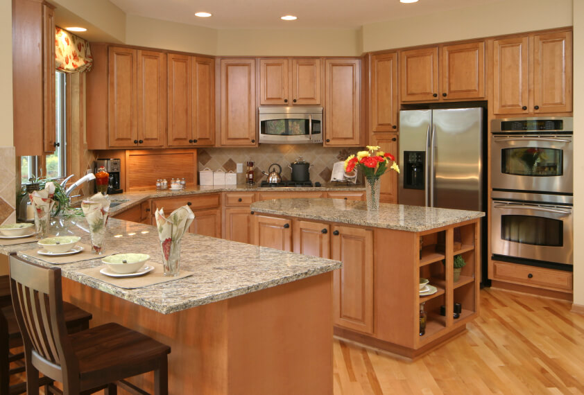 The Diagonal Planking Of This Wood Floor Accents Angled Countertops Kitchen