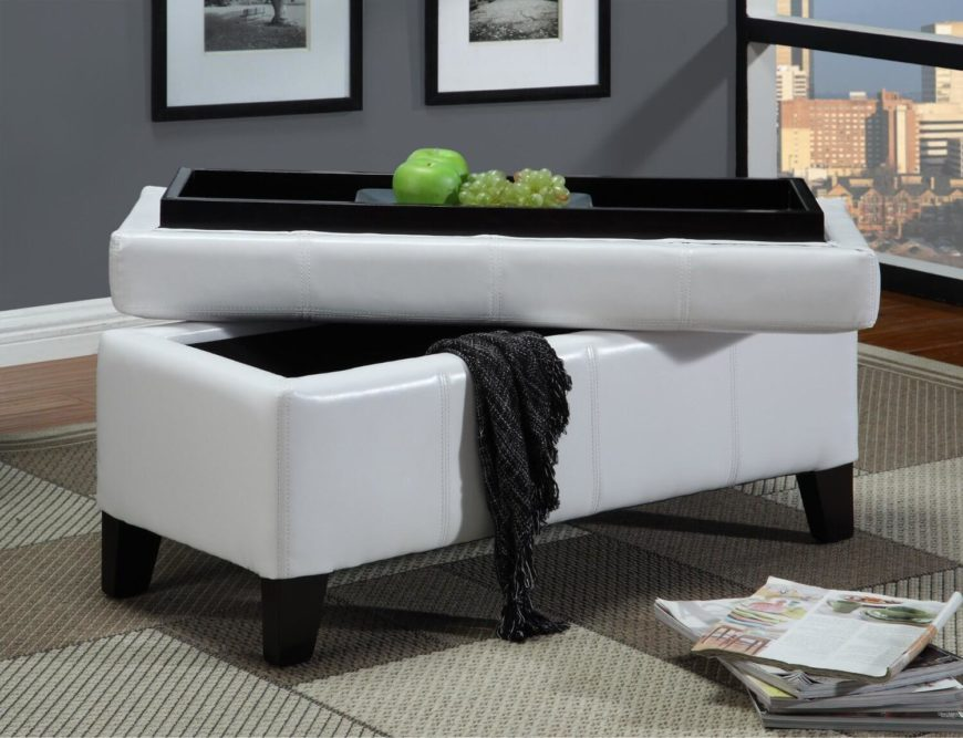 A luxurious felt-lined storage ottoman with a wooden tray built-in to the top. The ottoman also has removable feet to create a smoother, low profile look.