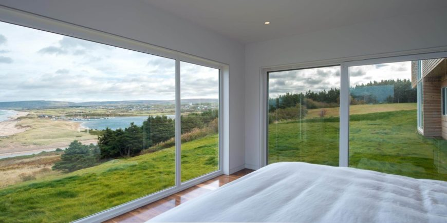 The master bedroom is of simple, minimalist design, with expansive seamless windows for the best view in the house.