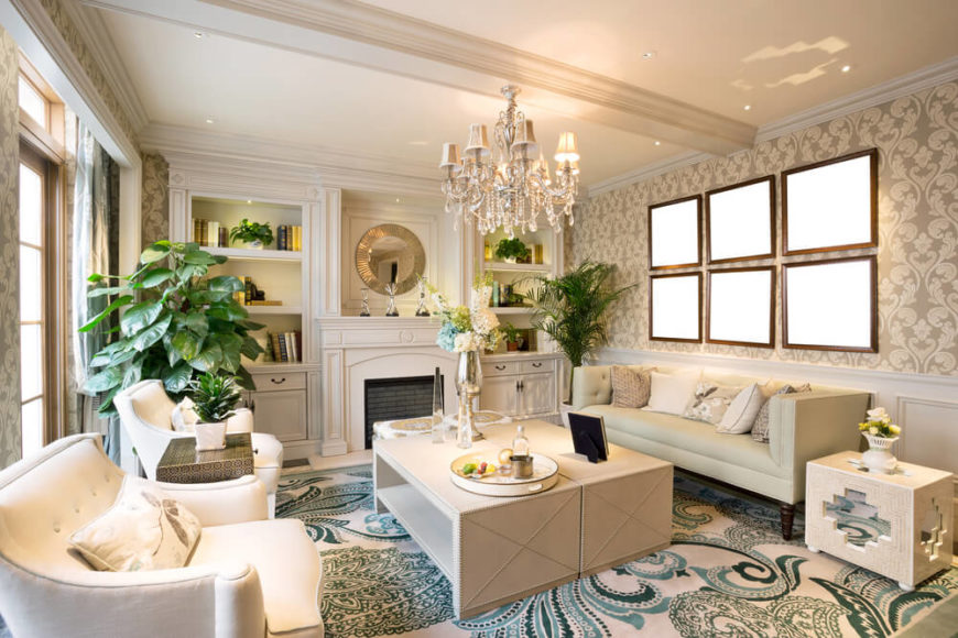 A Bold White And Blue Living Room With A Beautiful Crystal Chandelier Above  The Coffee Table