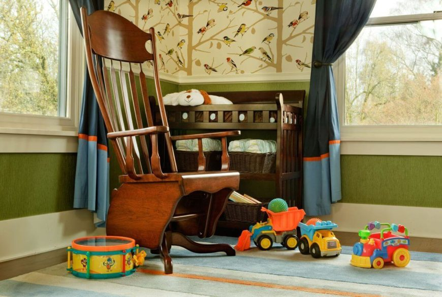A beautiful gender-neutral nursery with a dark wood changing table and a beautiful polished rocking chair. A soft area rug covers the rich hardwood floors that extend throughout the home.