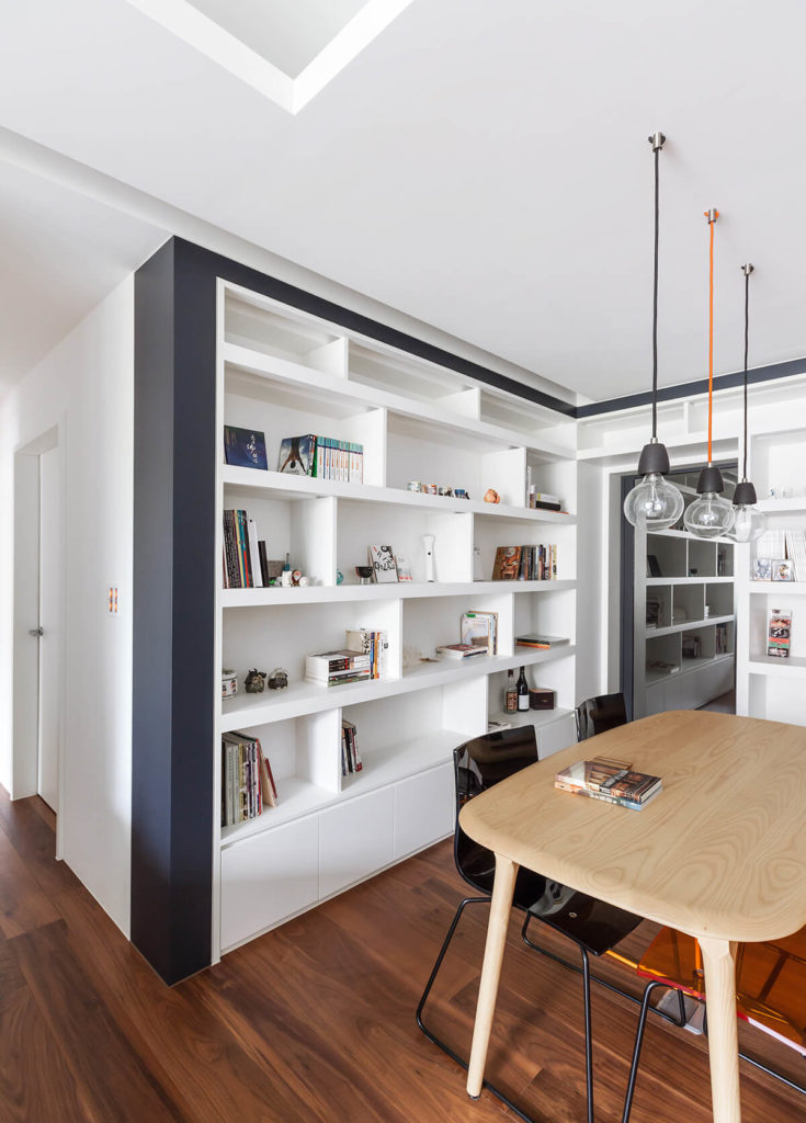 Returning to the bright light of day, we see the subtle color scheme evoked by the pendant light cords and dining chairs, with a golden orange hue standing out.