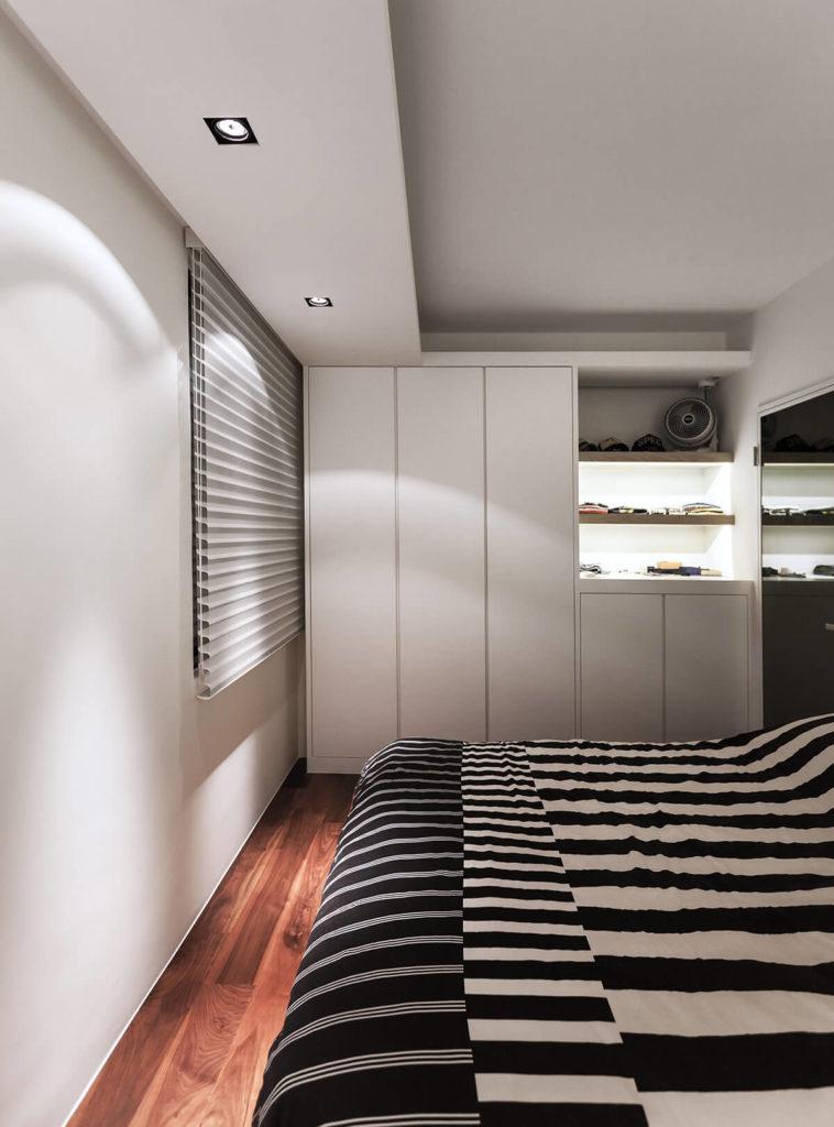 Sleek hardware-less cabinetry offers subtly hidden storage.