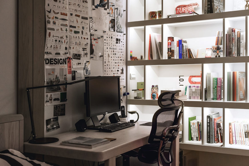 The private workspaces in the home make the most of the cozy, compact space with clean design and readily accessible supplies, courtesy of built-in shelving and storage.