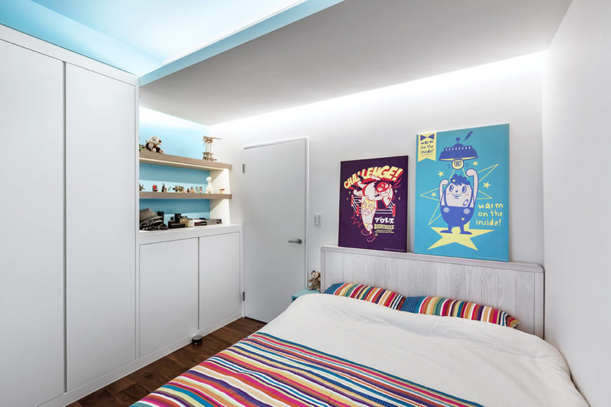 This second bedroom, bursting with color, stands in high contrast with the rest of the subtly appointed home.