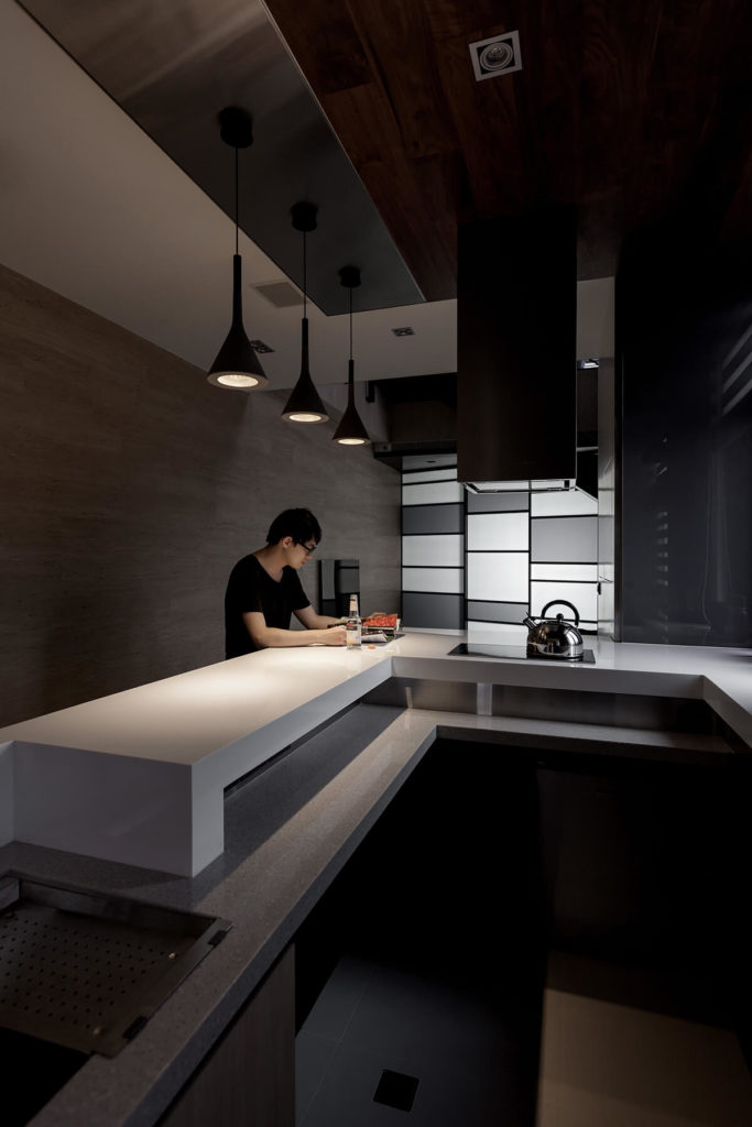 We leave you with an image of one of the homeowners enjoying his kitchen at night.