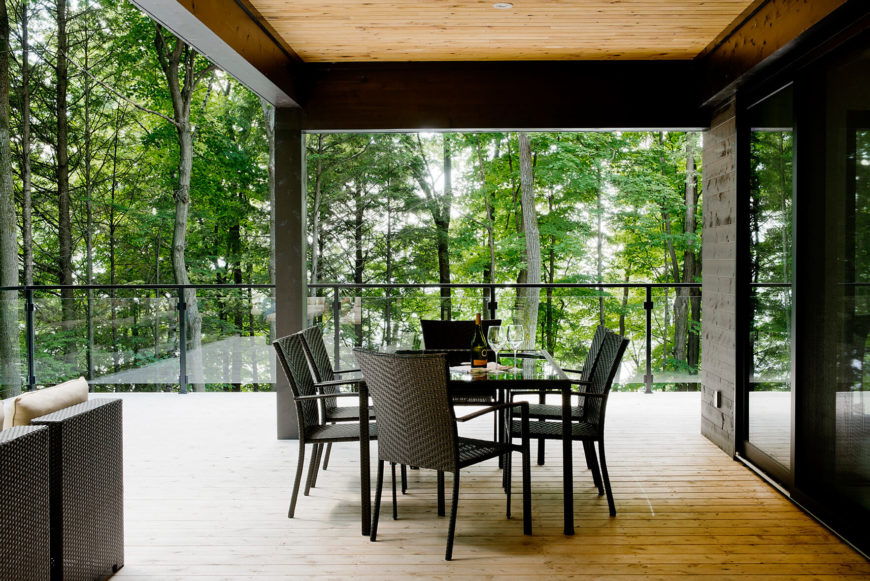 Turning toward the lake, we see the rattan dining set, with a glass topped table.