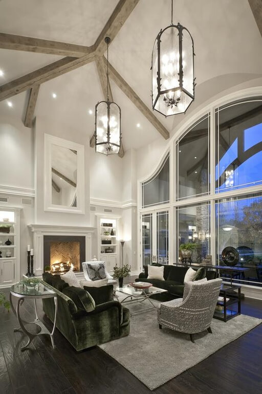 These ultra-dark wood floors are almost black and contrast beautifully with the white ceilings, built-ins, and fireplace. To bridge the gap between the two colors are shades of silver and gray in the richly textured furniture.