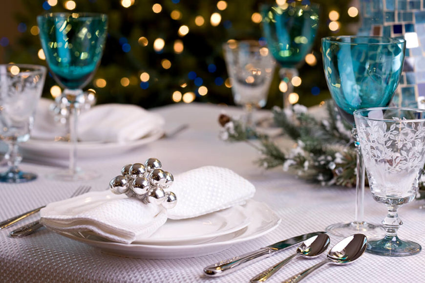 A Table Setting For A Holiday Party. Etched Water Goblets Are Paired With  Light Blue