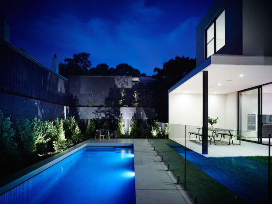At night the oasis-like pool is lit up with a sapphire glow. Tall glass balustrades close off the pool area from any small children or pets while supervision is lacking.