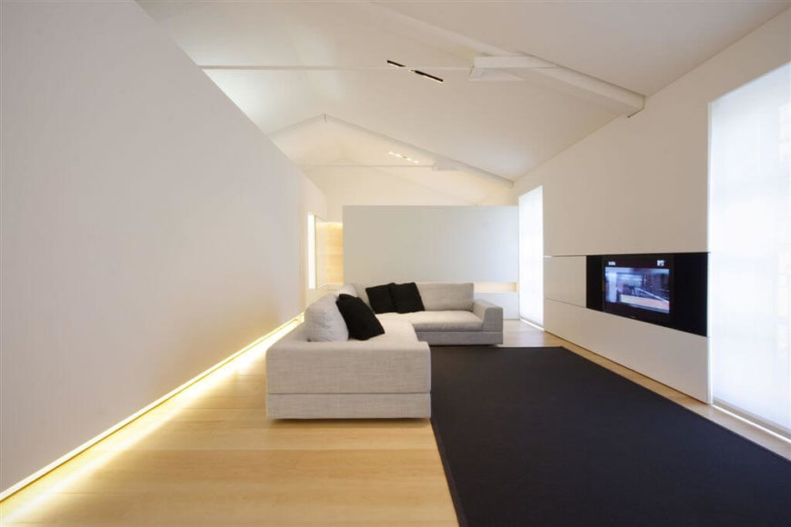 This minimalist living room does not need a lot of things for it to be elegant and unique. The hardwood flooring has a bright glimmer beside the luminous hidden lights under the walls.