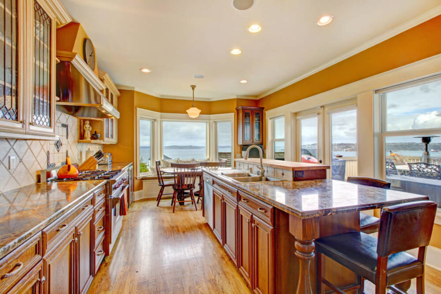 This classic styled home features a large bay window by the dining area to give a spectacular view during any meal. The marble counter tops unify the natural hardwood on the cabinets.