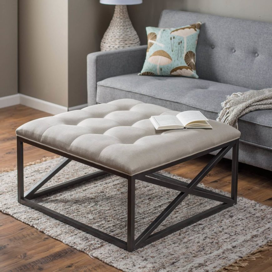 Occasionally, we come across hybrid pieces of furniture that serve more than one purpose. Here we have an ottoman that can serve as a sort of coffee table, with a metal frame and broad surface making for plentiful room atop.
