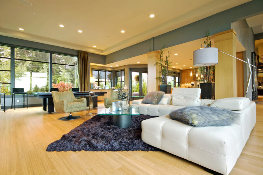 There Are A Lot Of Different Colors In This Living Room. From White To A