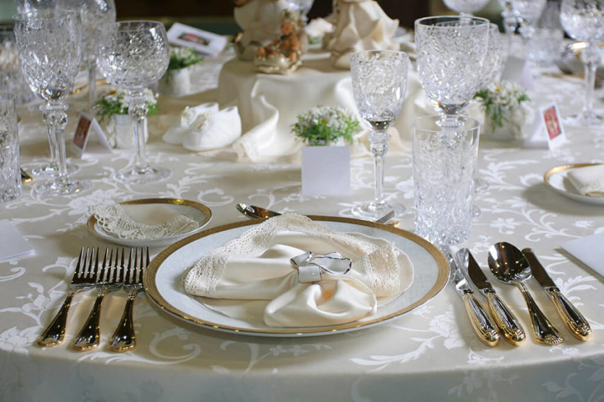 An absolutely delicate place setting on a white tablecloth. The silver rim of the plate & 44 Terrific Table Setting Ideas for Dinner Parties u0026 Holidays (2018)