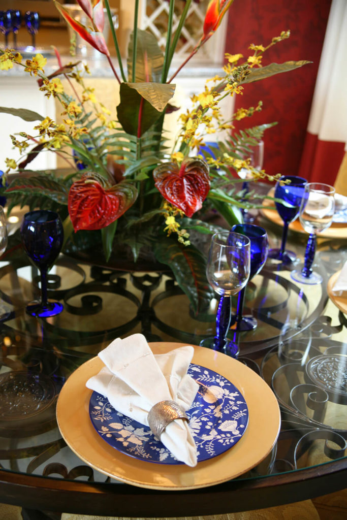 A Table Set For A Semi Formal Dinner On A Wrought Iron Glass