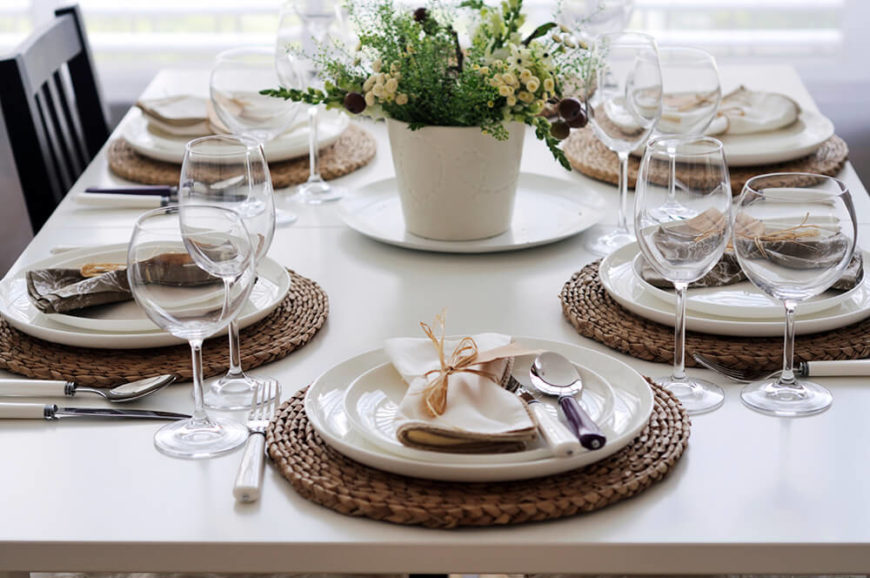 The woven wicker placemats help distinguish the glossy white plates from the matte white dining table & 44 Terrific Table Setting Ideas for Dinner Parties u0026 Holidays (2018)