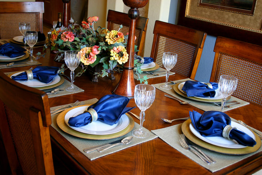 Bold sapphire blue napkins lay on white salad plates atop golden dinner plates. The placemats & 44 Terrific Table Setting Ideas for Dinner Parties \u0026 Holidays (2018)