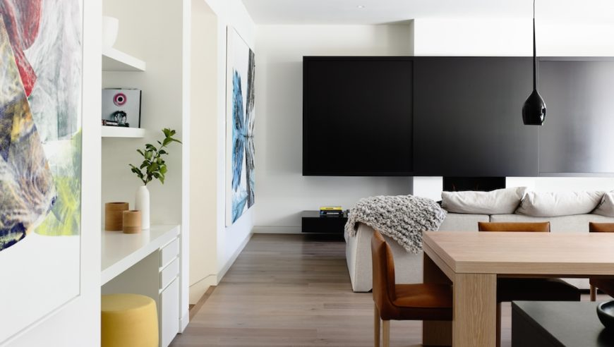 Before heading down the hallway, we turn to the right to view the family room, which is dominated by the enormous television in front of the sectional sofa.
