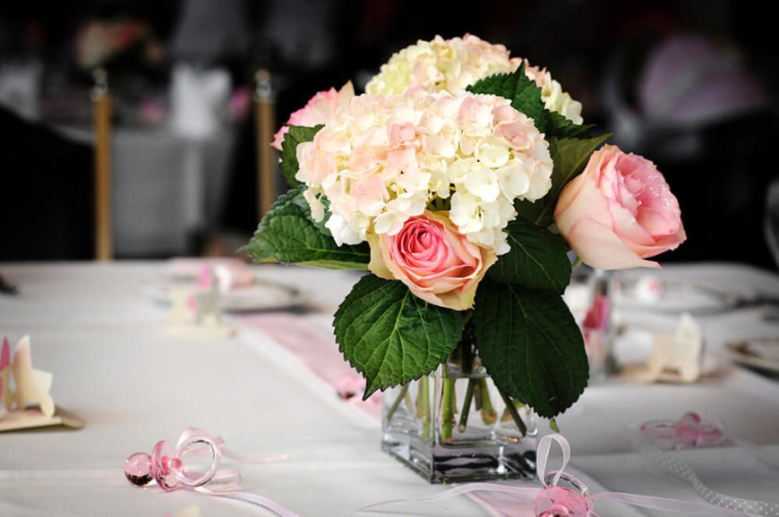 A Beautiful Floral Arrangement Of Light Pink Roses And White Hydrangeas  With A Soft Touch Of