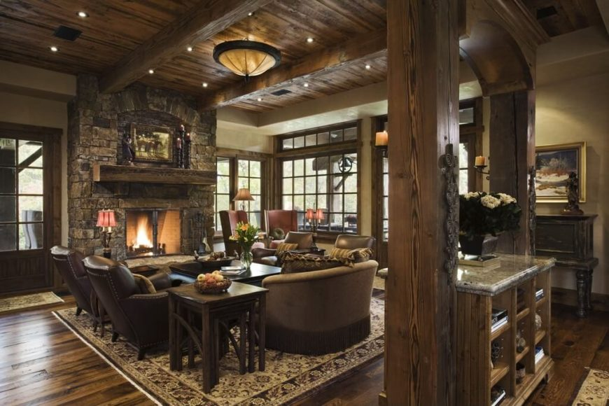 A rustic yet elegant living room in wood and stone. The wood-burning  fireplace