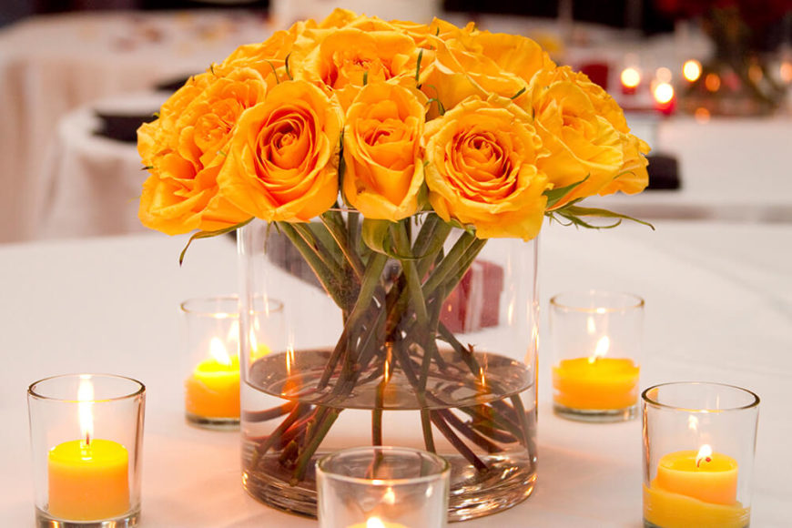 33 extravagant floral arrangements for your dining table this floral centerpiece consists of beautiful bright yellow roses in a wide glass vase the mightylinksfo