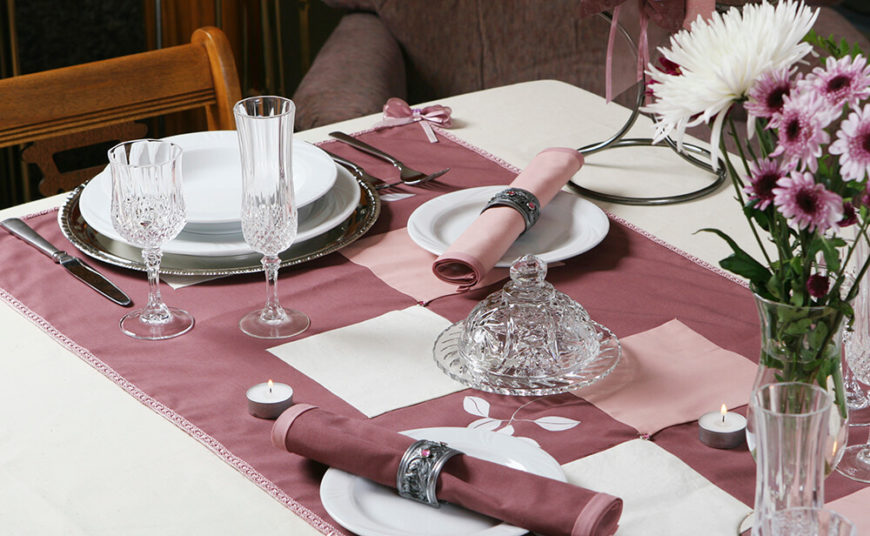 A Fiercely Elegant Table Setting In Mauve With Crystal Ware Glasses And  Jeweled Silver Napkin Rings