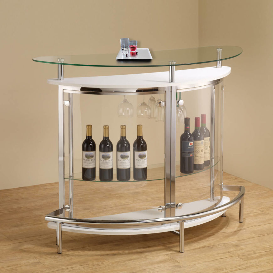 If your man cave is on the fresher side of contemporary, you might prefer a glass bar setup, transparent and held together with sleek minimalist metal frame. This setup conserves space and helps showcase a fine liquor collection.