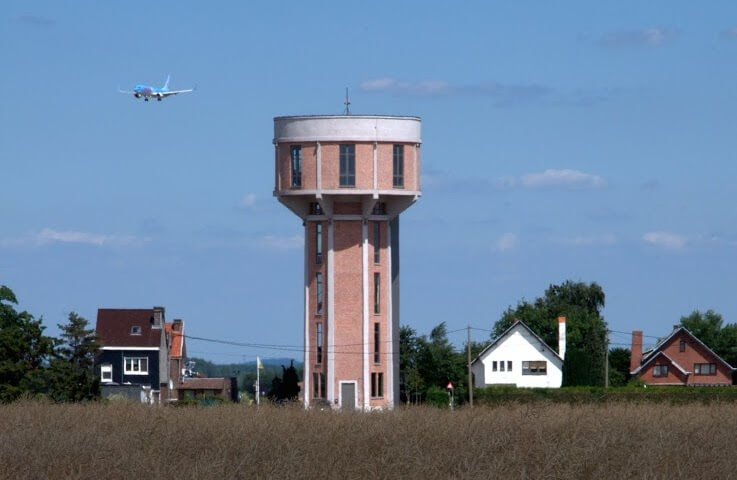 The water tower structure offers an extremely novel layout for the designers to create a home in.