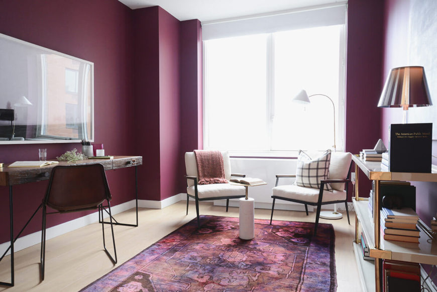 The sublimely purple home office rises from a matching patterned area run to wrap walls in the distinctive hue. This splash of color helps the home office stand out within the home.
