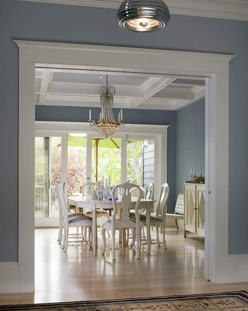 Upon entering this sumptuous dining room, attention is drawn to the Queen Anne chairs, which have been painted white to give them an exclusively contemporary feel. While the original coffered ceilings are still intact, small recessed lighting fixtures have been installed.
