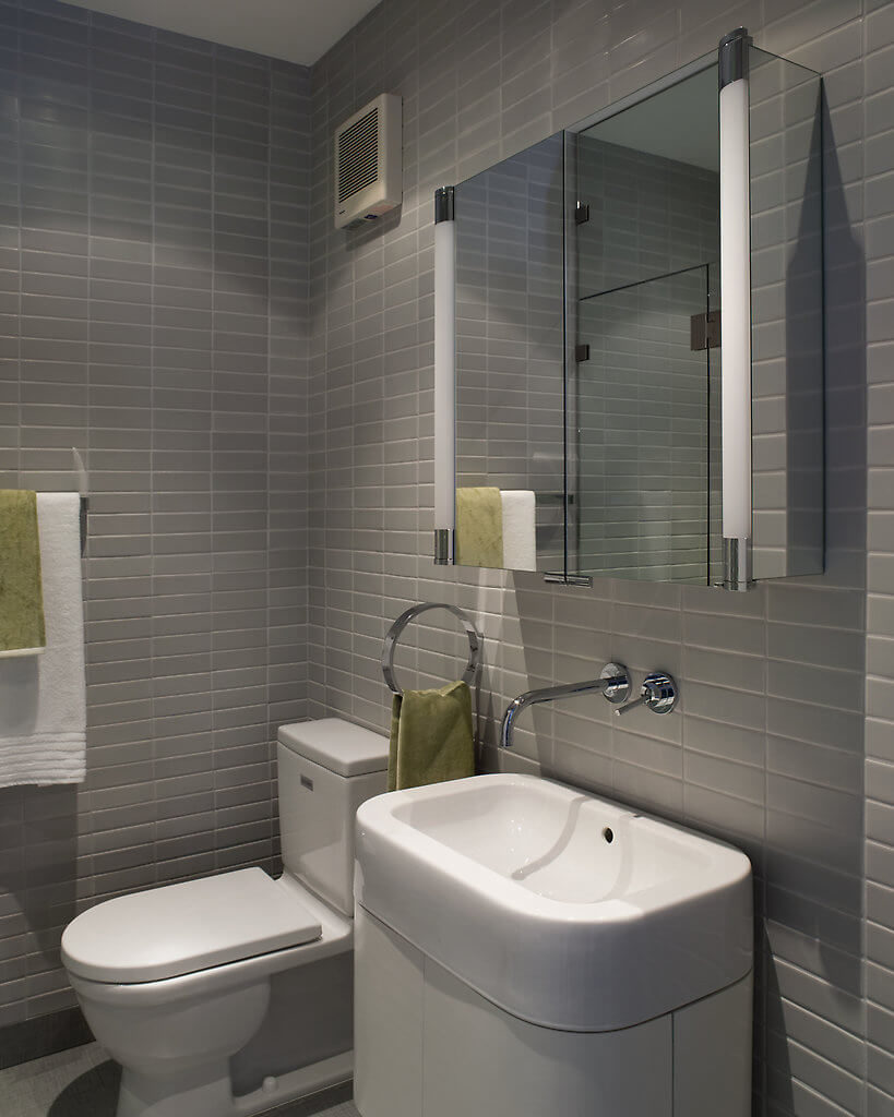 Long accents provided by the lighting on either side of the mirror are paired with the modern design of the mirror and its refreshing take on the medicine cabinet.