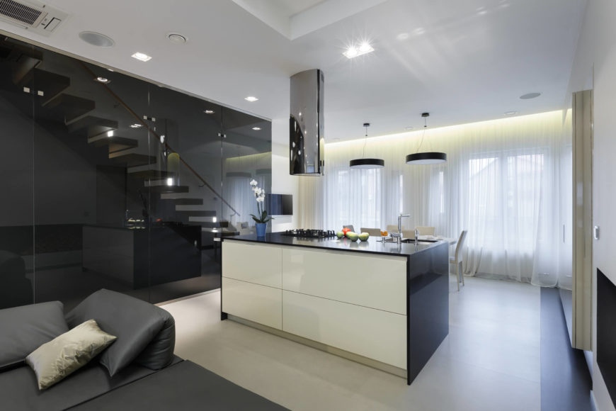 The kitchen area is concise to provide a plenty of space in this beautiful apartment. An island contains all that is needed for day to day needs, and is directly connected to the dining room.