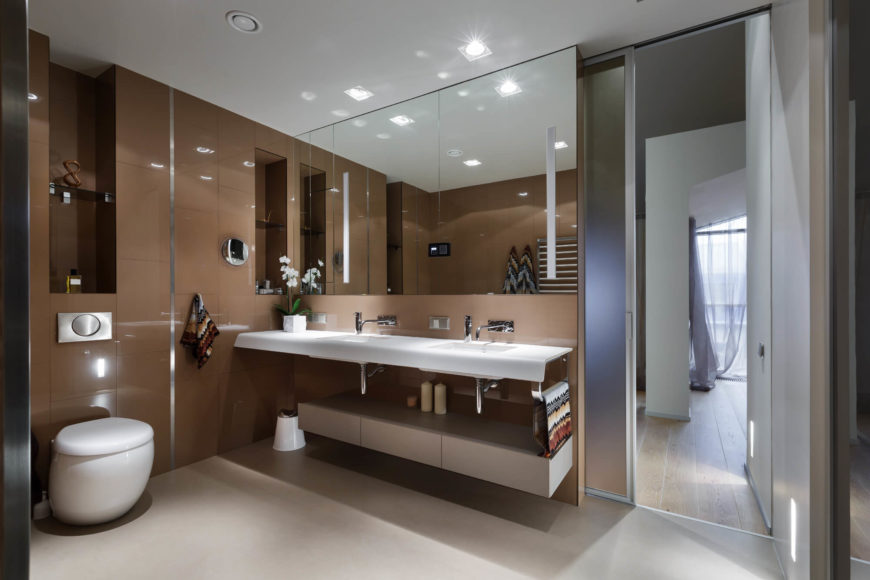 The master bathroom is a giant leap from the second bathroom. With sleek taupe walls, the space is seamless and chic.