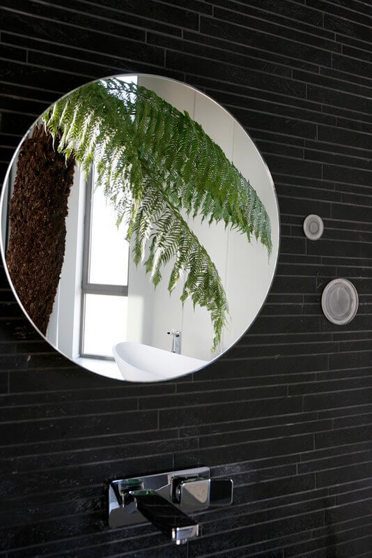 A close up of the bathroom's mirror reveals the sleek way the lights have been integrated into the wall.
